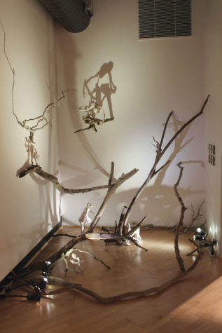 "BRANCHING OUT. Abbey Syme's ('16) installation piece in the Kristin Wigley-Flemming Gallery is inspired by the play ""The Life and Death of Doctor Faustus."""