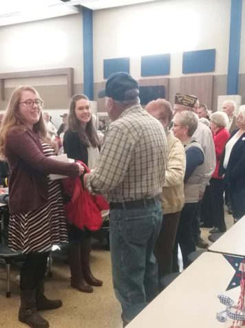 Brooke Hilger ('17) shakes hands with a Decorah veteran.