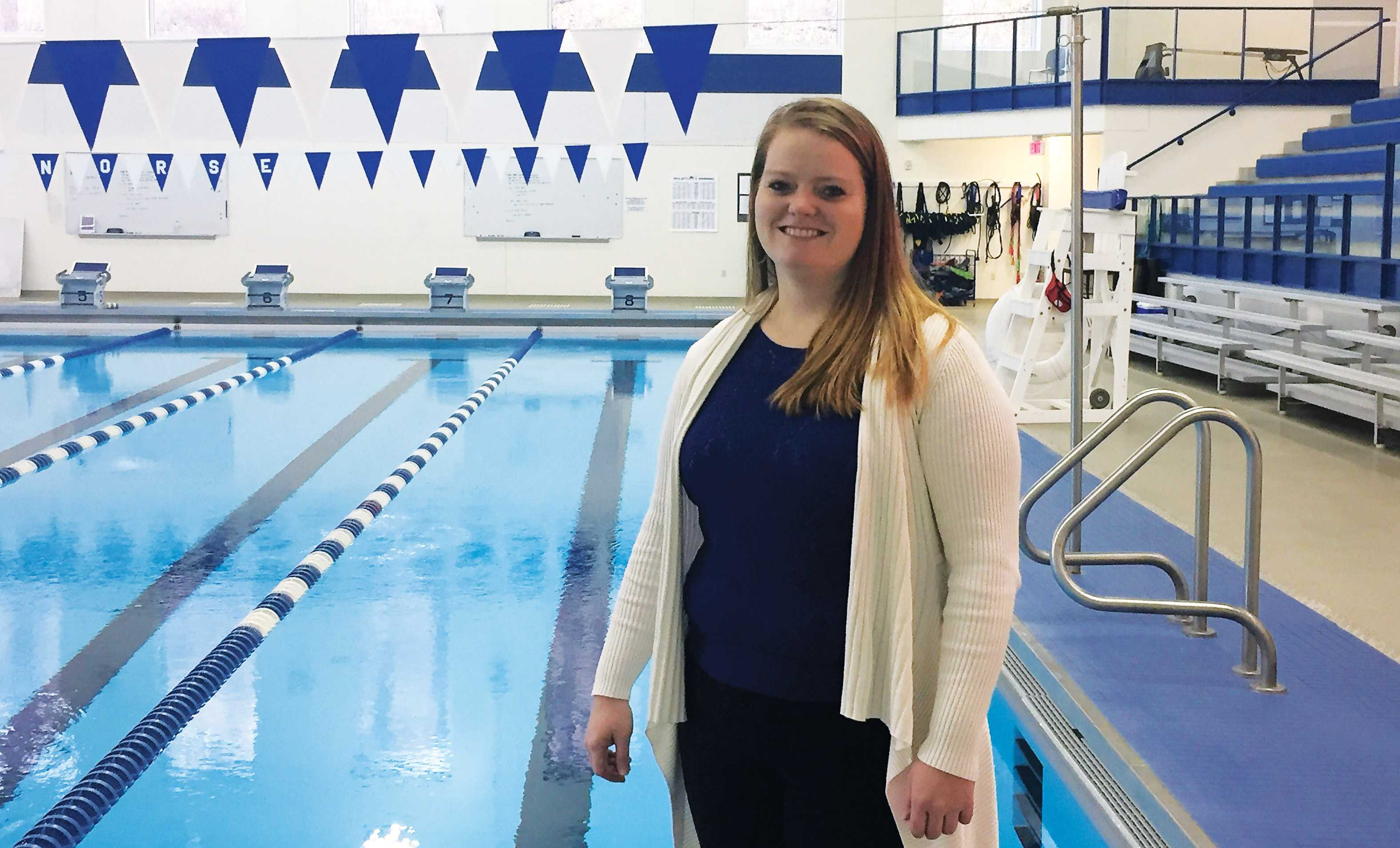 Head Swim and Dive Coach Nicole Kaupp stands in the Luther College Aquatic Center.