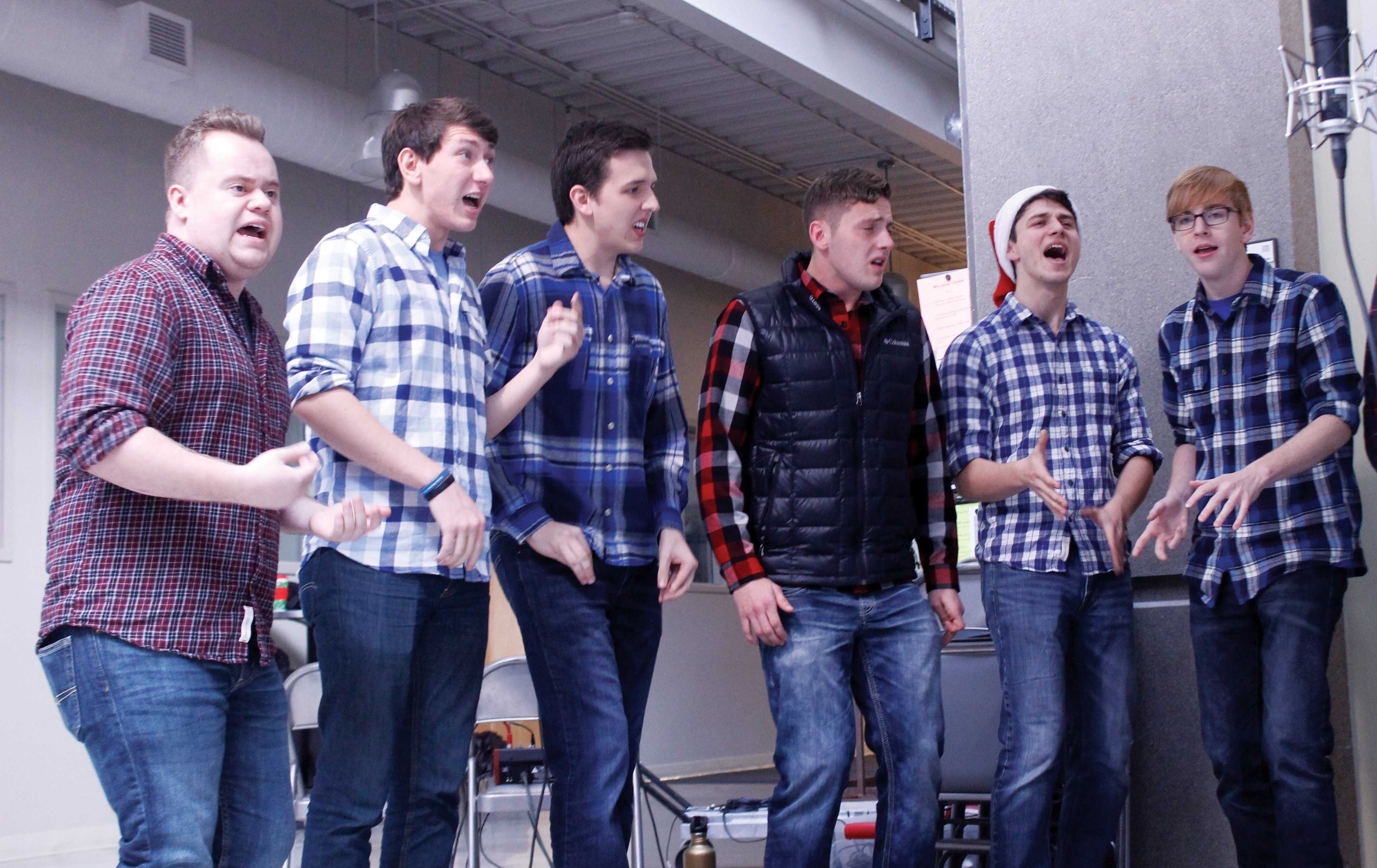 Andrew Botz ('18), Jacob Bungee ('18), Mason Montuoro ('18), Max Rooney ('17), Parker Fretheim ('19) and John Bendt ('20) from Bromatic Progression perform a group a capella piece.