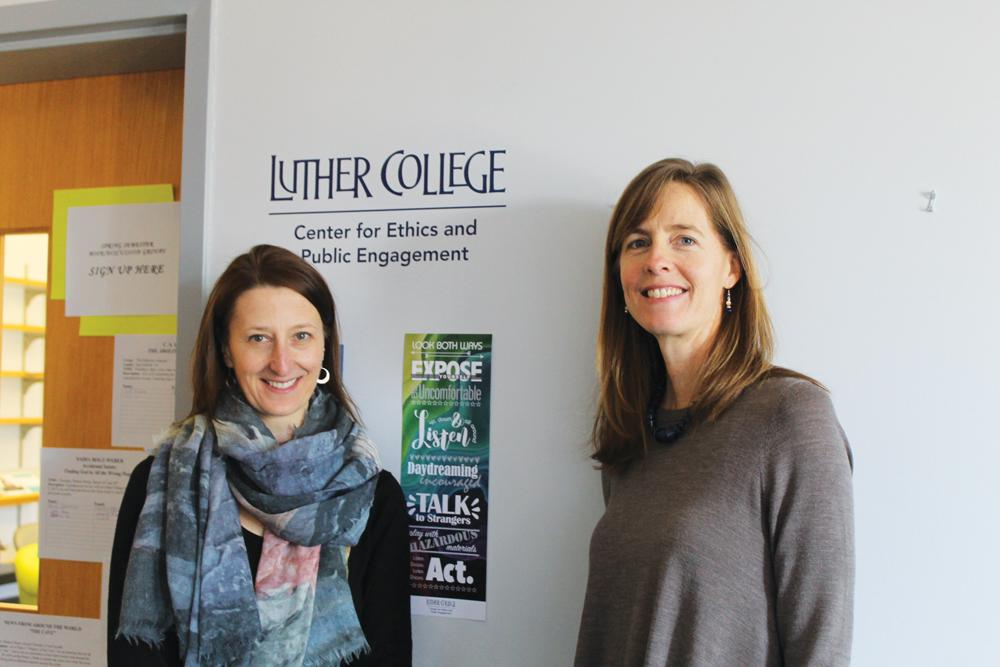 Victoria Christman and Krista Holland pose in the new Center for Ethics and Public Engagement office.