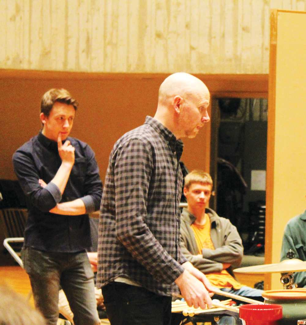 Sam Haefner ('18) observes a member of Sō Percussion in the masterclass.