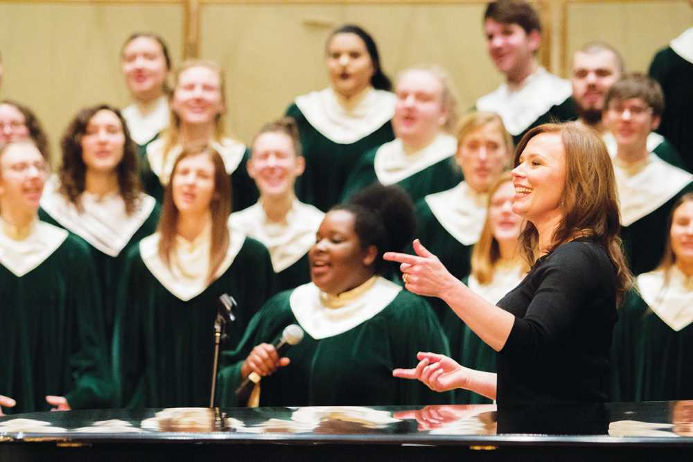 Jennaya Robison ('96) conducts Cathedral Choir at Gospel Sunday Worship Service.