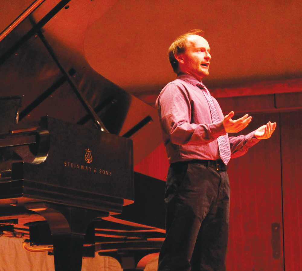 Adjunct Faculty in Music Jonathon Struve ('02) performs in the Noble Recital Hall.