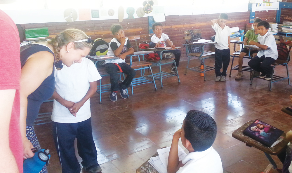 Mission Trip volunteers chat with students in a school in Nicaragua.