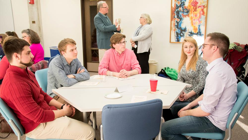 Students speak with an alum at the English Department Careers Day.