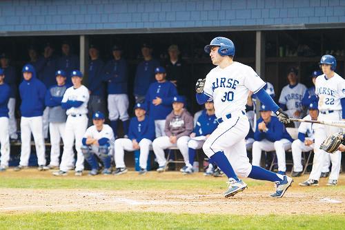 Team cheers on Cody Reimer ('17) at bat during last year's season.