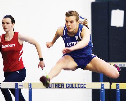 Jackie Krawczyk ('18) hurdling at Luther College Alumni meet.