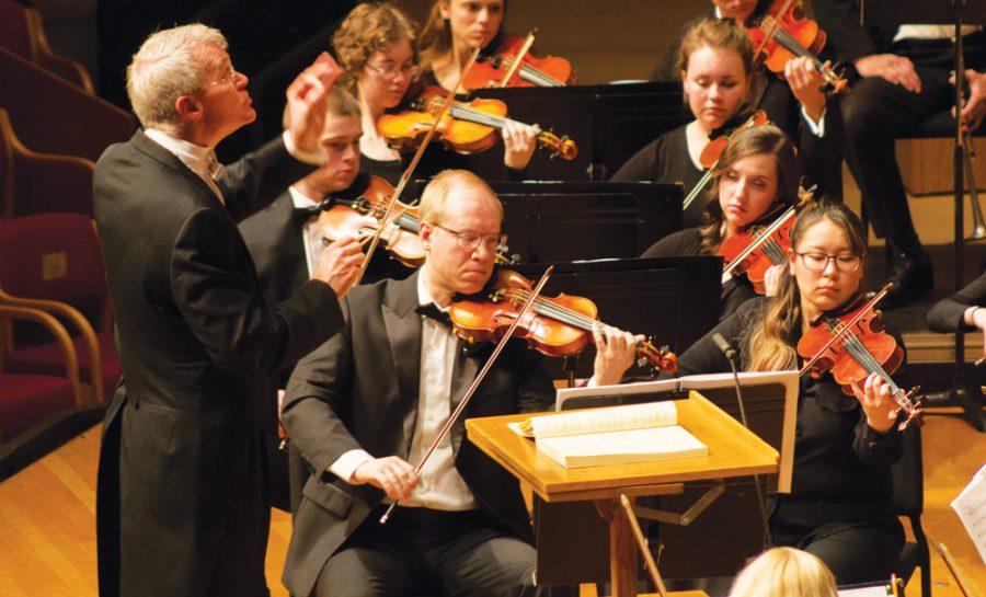 Professor+of+Music+Daniel+Baldwin+conducts+Symphony+Orchestra.