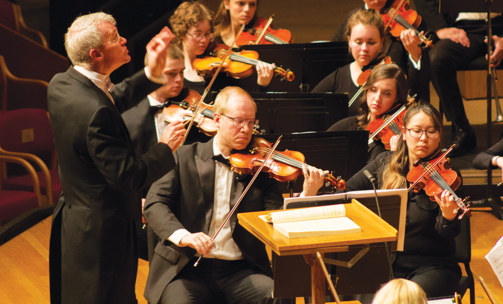 Professor of Music Daniel Baldwin conducts Symphony Orchestra.