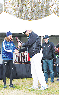 Isaac Jensen ('17) accepts the  All-American award at the National meet.