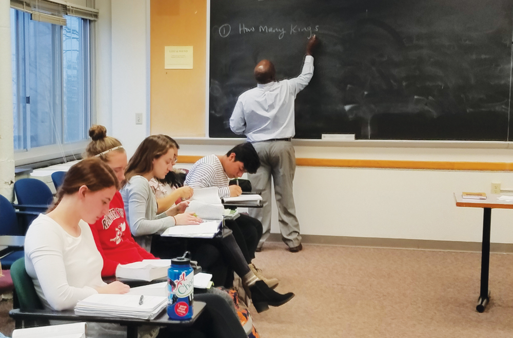Visiting Assistant Professor of Religion Robert Wafula teaches  class.