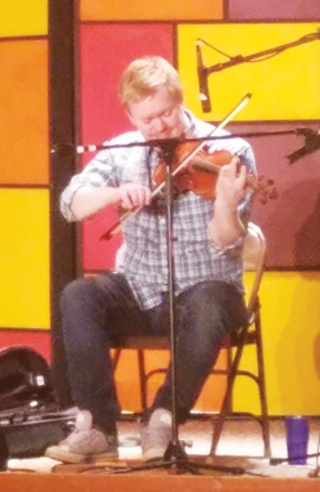 Nordic Folk Musician Vidar Skrede plays the fiddle in Marty's.