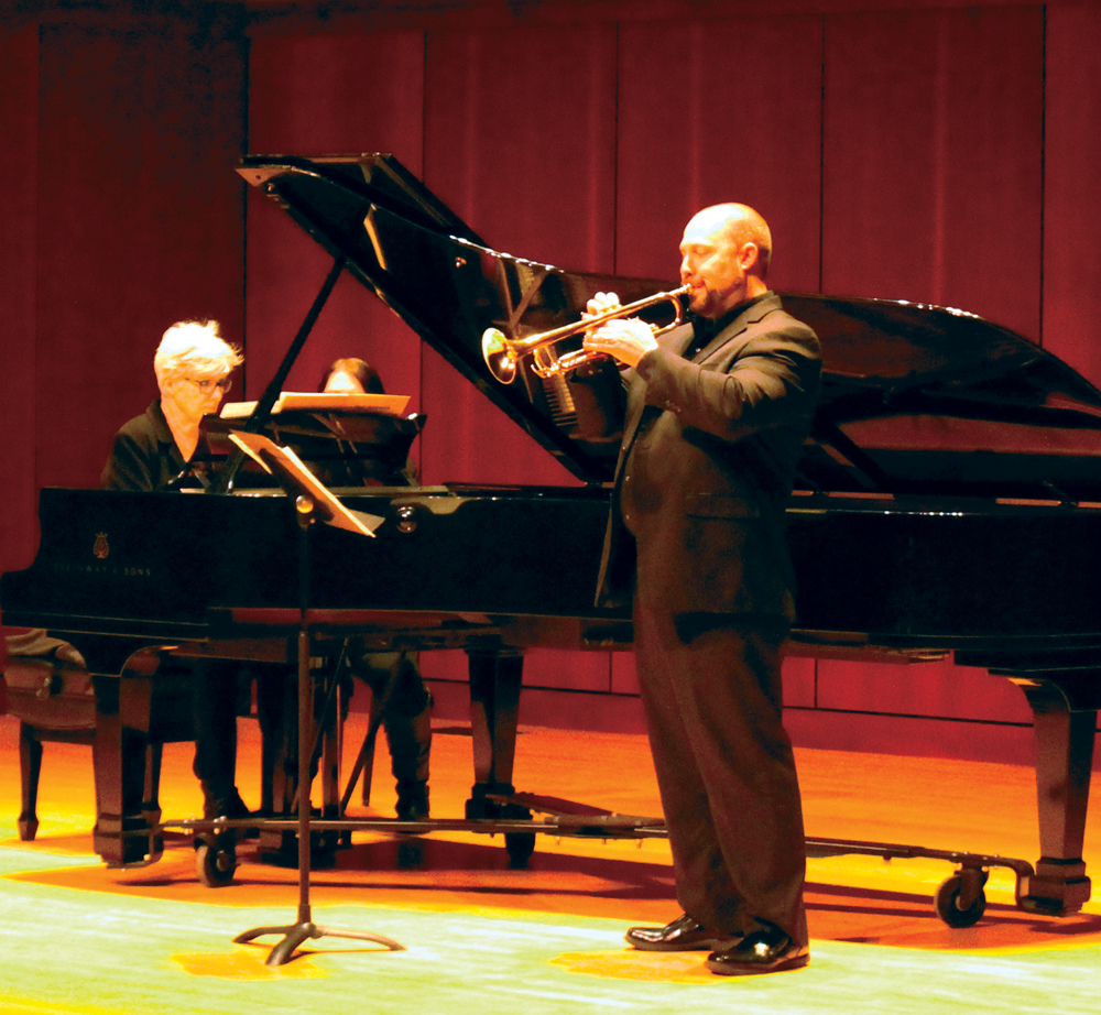 Assistant Professor of Music John Cord plays the trumpet.