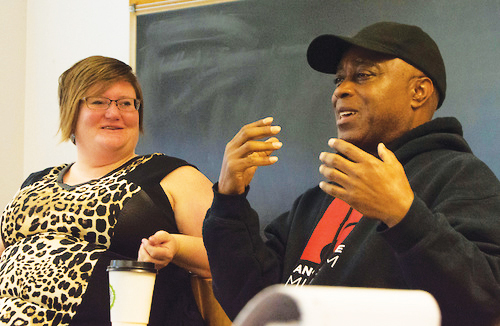 Assistant Professor of Africana Studies and History Lauren Anderson listens as guest speaker Charles Burnett speaks.