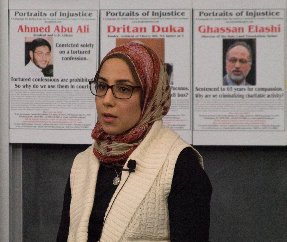 Mariam+Abu-Ali+addresses+the+audience.+Behind+Abu-Ali+are+posters+of+those+imprisoned+under+the+auspices+of+terrorism-related+investigations.