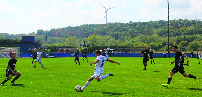 Bernardo Marotti ('18) passes the ball down field.