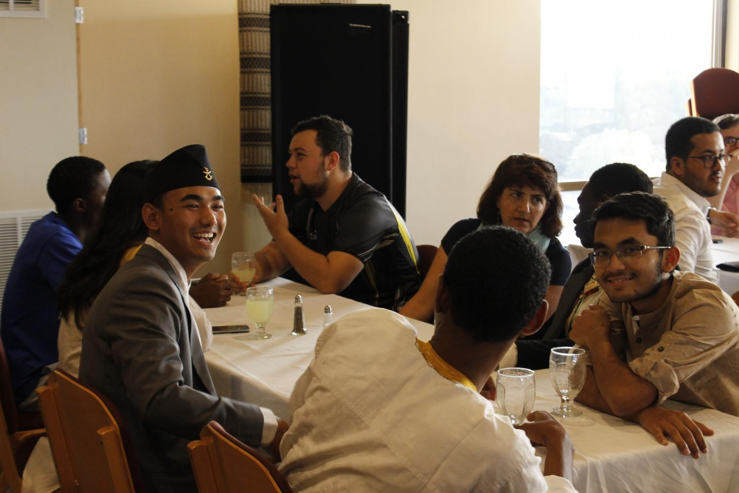 Yukesh Mikchan ('21) holds a conversation during the 2017 International Student Welcome Dinner.