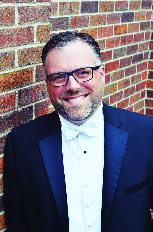 Mark+Potvin+graduated+in+2001+and+sang+for+both+the+ensembles+he+now+conducts.+