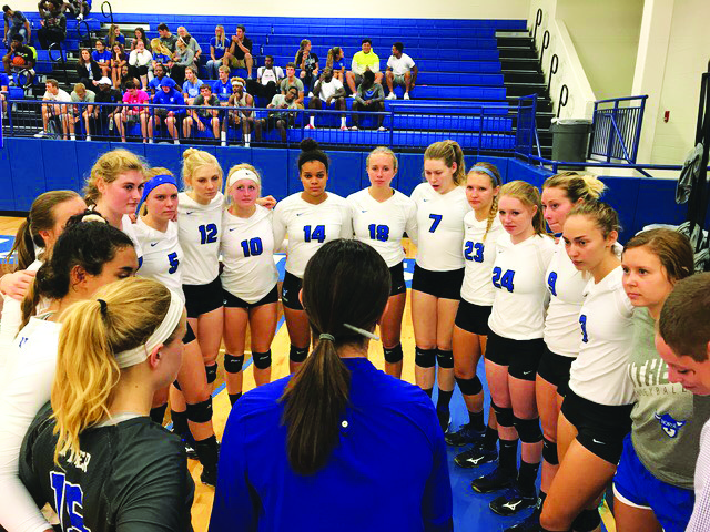 The+volleyball+team+meets+with+Head+Coach+Danielle+Kohut+prior+to+the+game.+