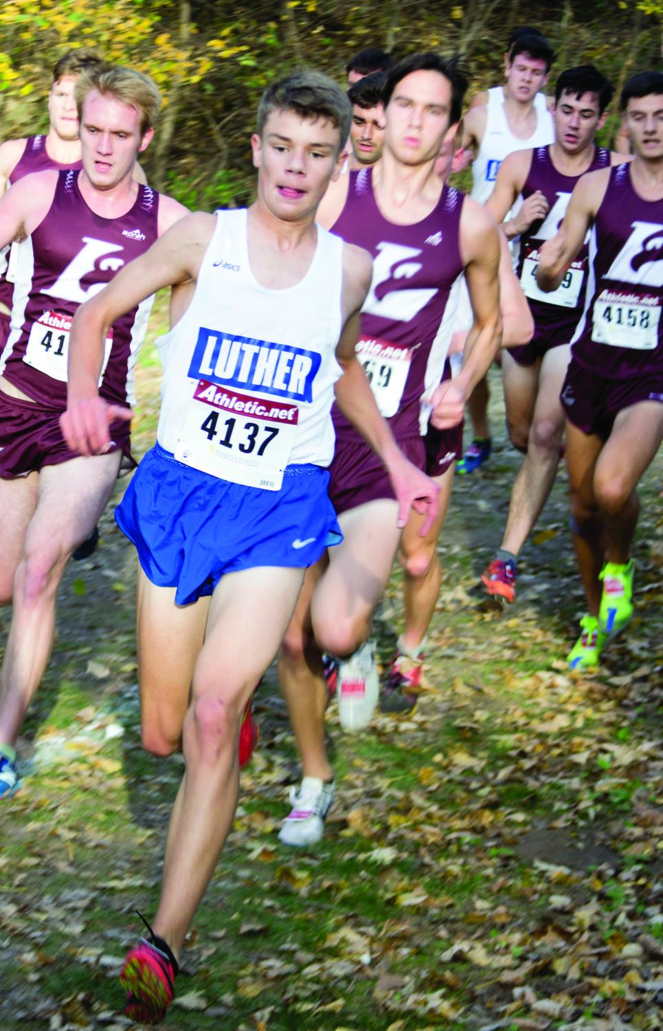 Maximilian Walker (21) cruises downhill,  a pack of La Crosse runners in pursuit during the dual.