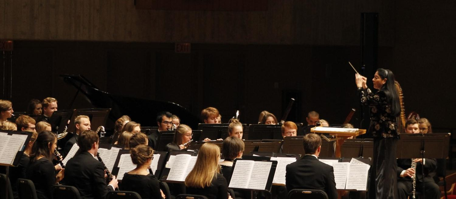 Director of Bands and Associate Professor of Music Joan deAlbuquerque conducts Concert Band during the Homecoming Concert.