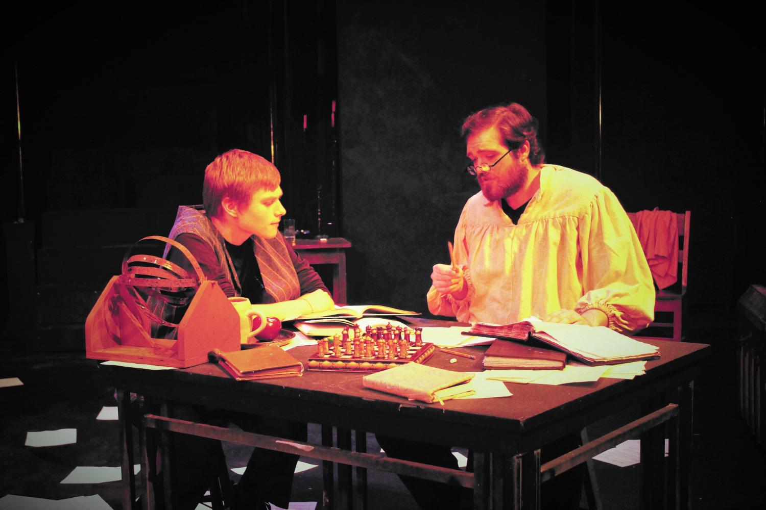 "Nathan Sunde ('21) plays Andrea Sarti, a student of Galileo Galilei, who is played by Erik Mueterthies ('18) in ""Life of Galileo."""