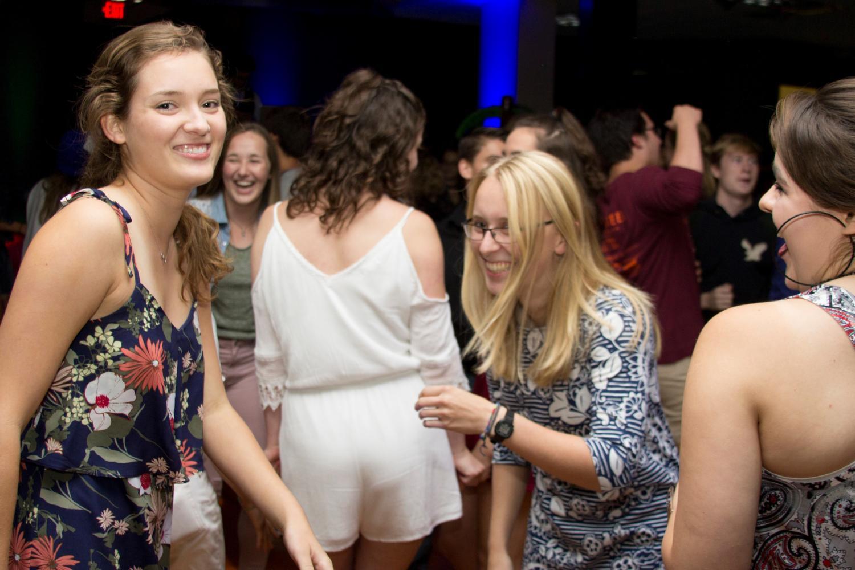 Maya Evans ('19) and Sari Kroschel ('19) enjoy good company and fun music at the Flamingo Ball.