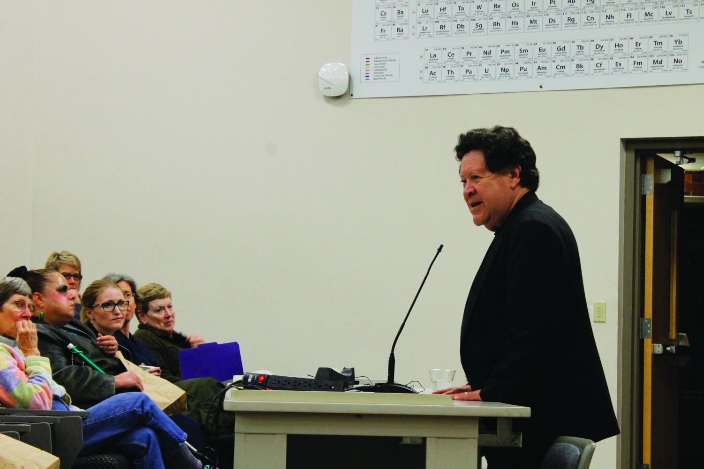 Luis Argueta speaks to the audience in Valders 206.