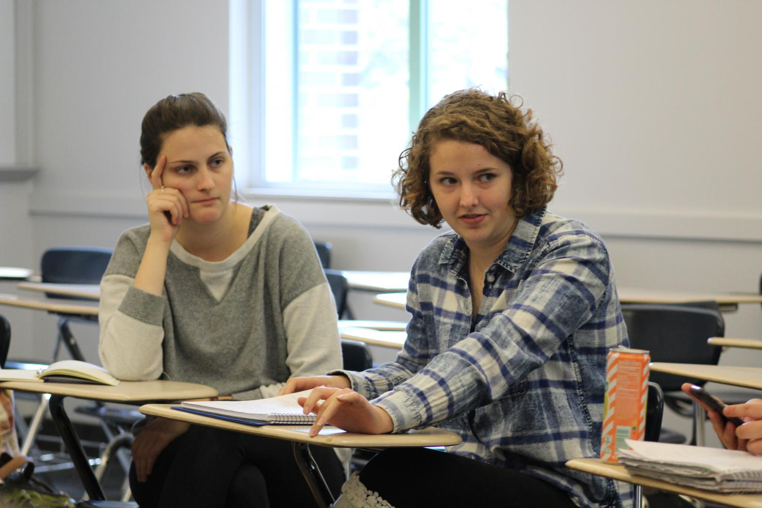 Anna Becker ('19) and Gillian Allison ('21) engage in discussion during the fall introduction to Women and Gender Studies course.