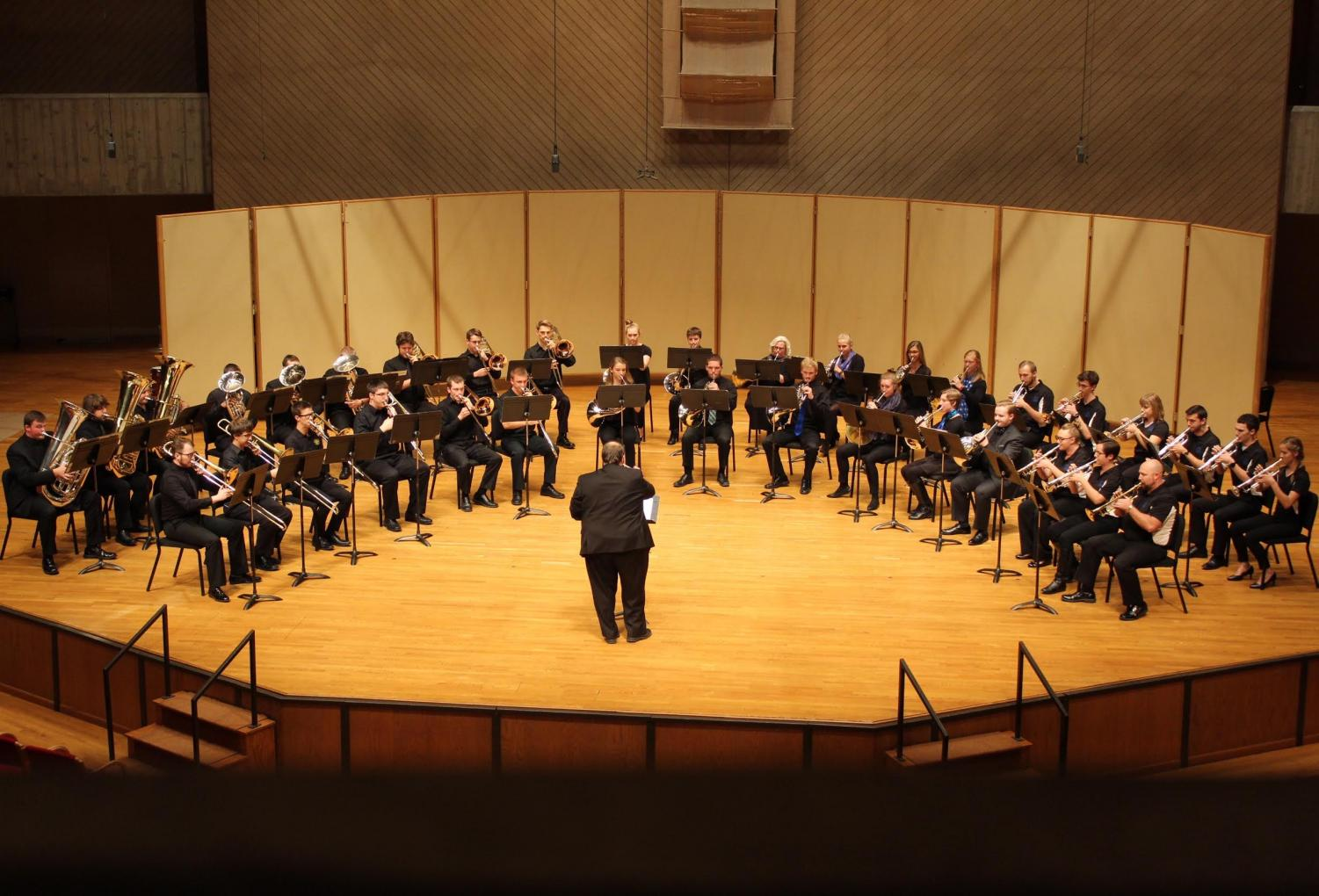 "The Brass Choir performs ""Out of the Depths I Cry to Thee: Thematic Transformations for Brass Choir,"" which was written and conducted by Associate Professor of Music Michael Smith."