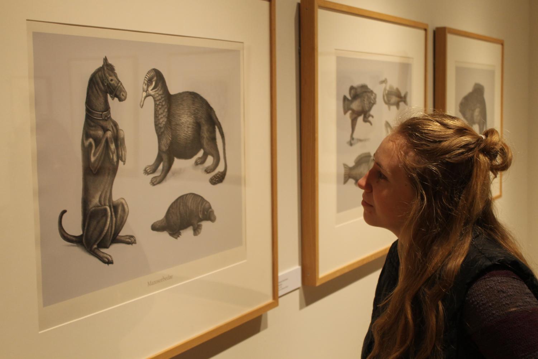 Hannah Perendy ('20) admires Beauvais Lyons's artwork.