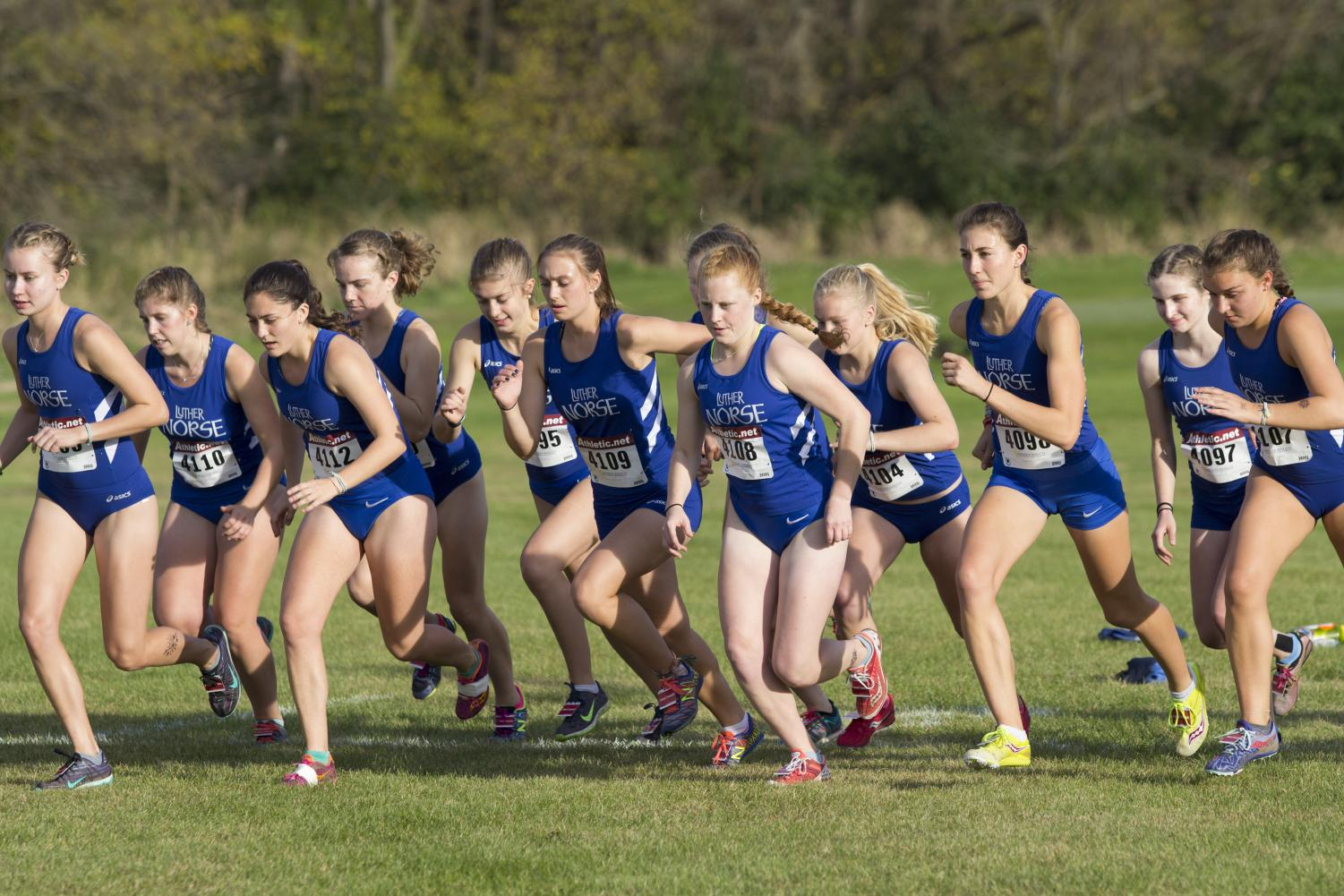 The women's cross country team starts a race during their meet against LaCrosse.