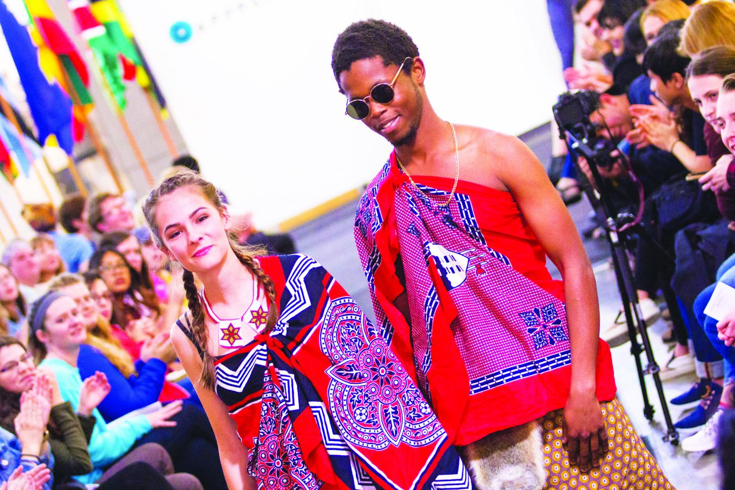 Lauren Knuckey ('19) and Malu Mndzebele ('21) in the 2017 International Fashion  Show, demonstrating cultural appreciation. They are both wearing  the traditional attire of Swaziland called 'emahiya.'