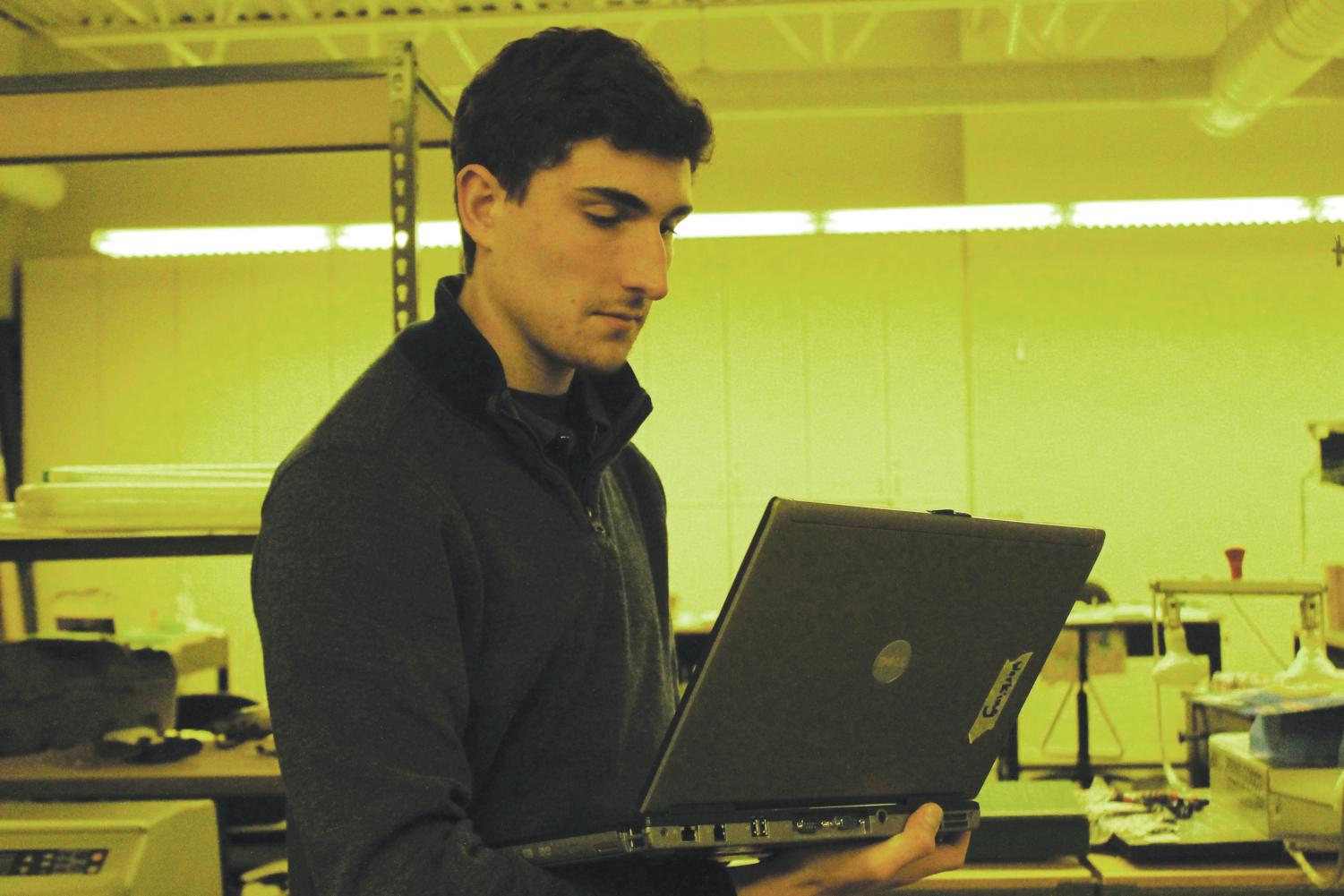 Alexander Davis ('19) works on a computer during a CSS meeting.