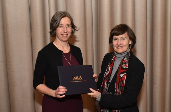 Associate Professor of Spanish Nancy Gates Madsen poses with first Vice President of the Modern Language Association Anne Ruggles Gere  after receiving the Katherine Singer Kovacs Prize.