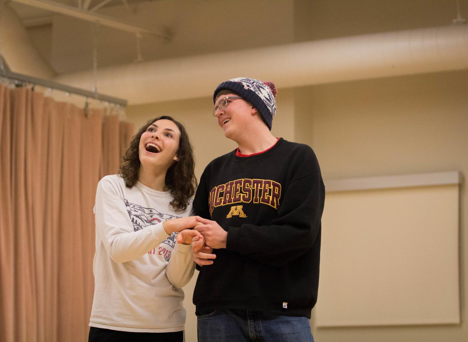 Annika Peterson ('19) and Karl Nycklemoe ('18) show affection during a scene.