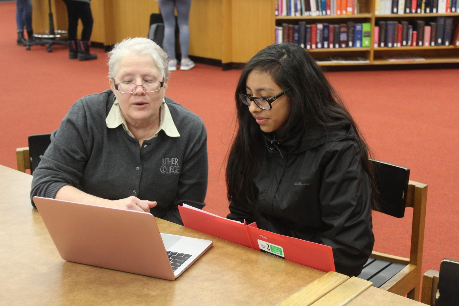 Professor of History Jackie Wilkie helps Lorelayn Coto ('21) with research for Paideia.