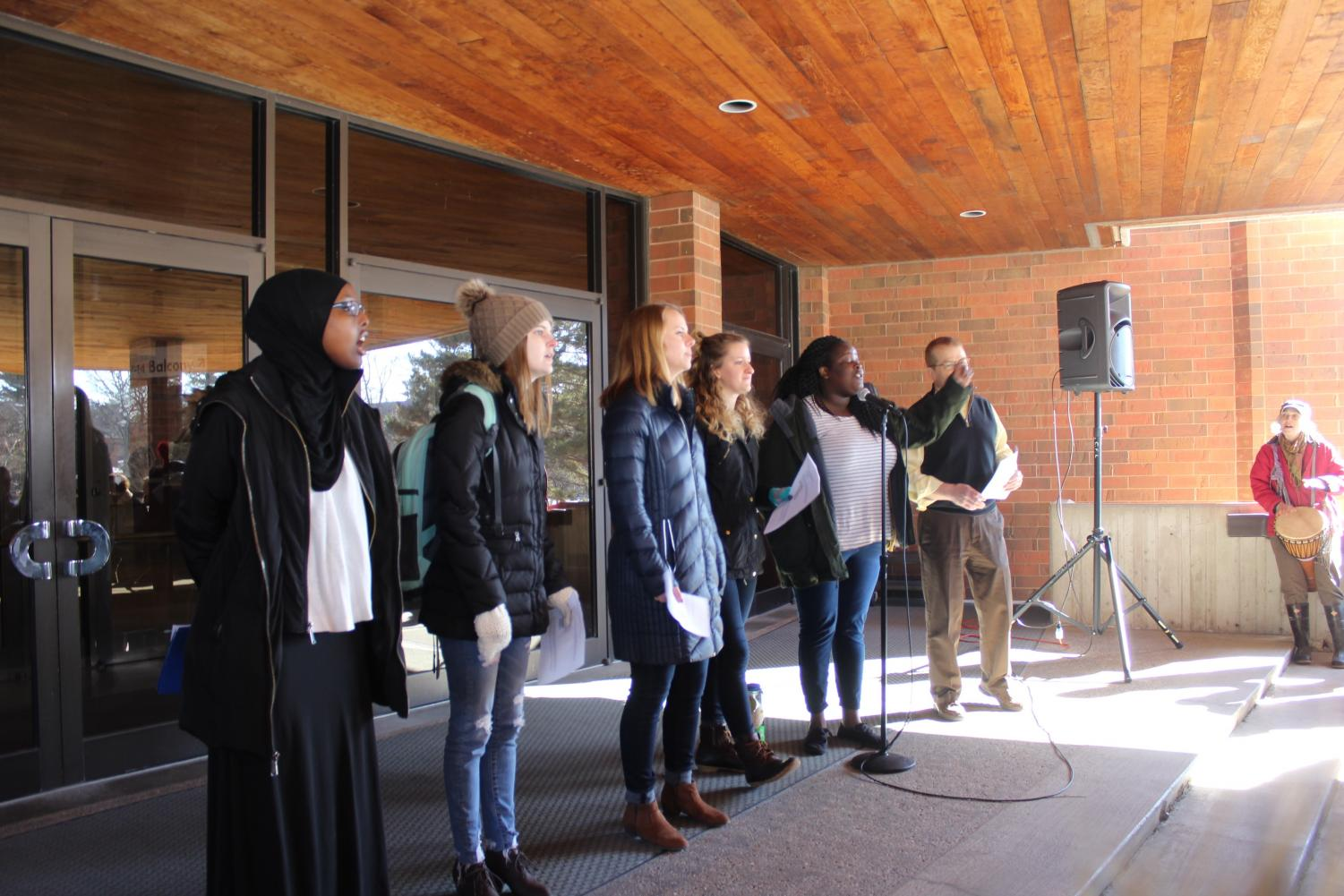 Asha Aden ('20), Katie Moon ('19), Forrest Schrader ('18), Johanna Beaupre ('18), Janet Irakunda ('19), and College Pastor Mike Blair lead attendees in song, talk and prayer.