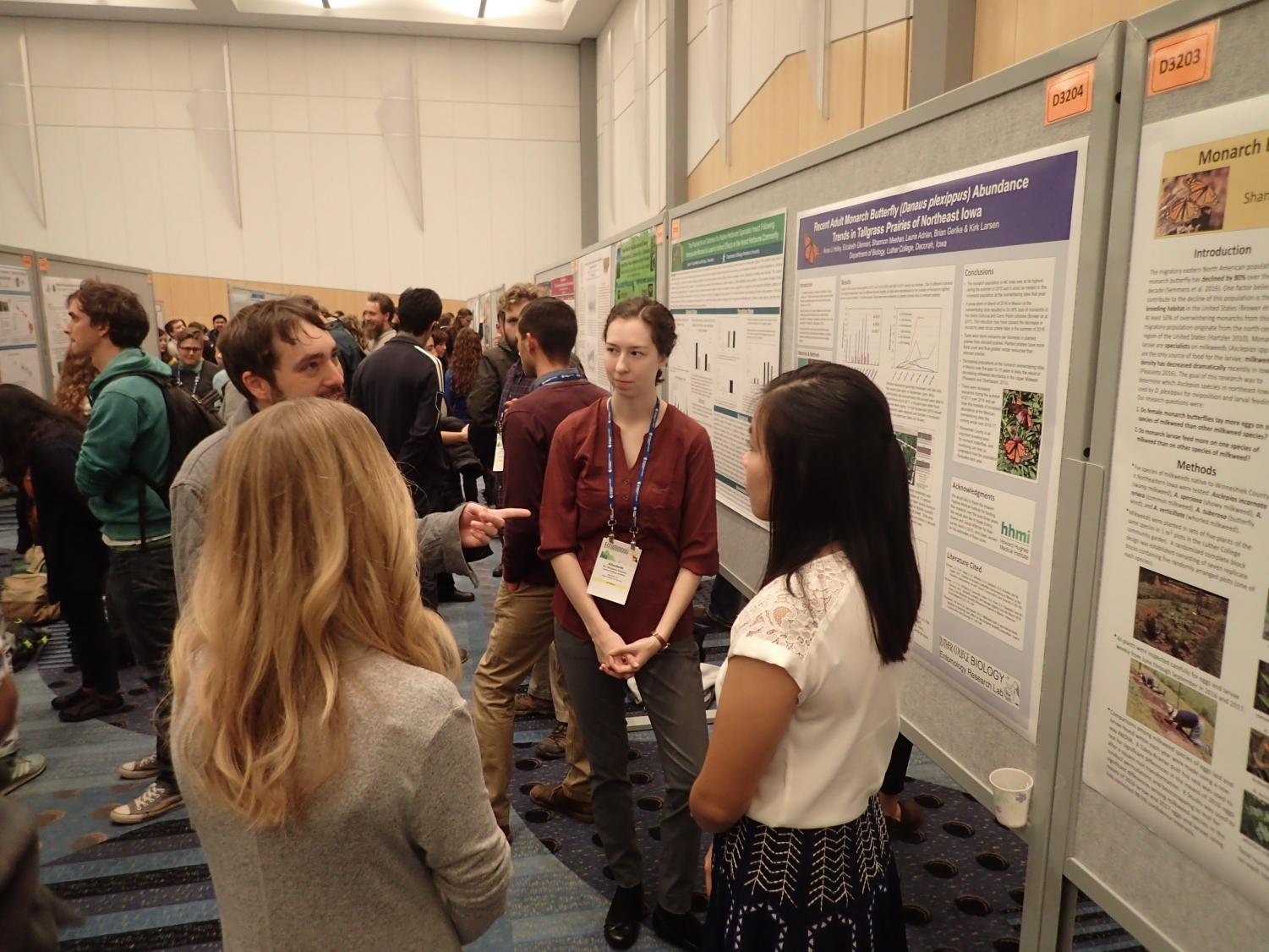 Laurie Adrian ('16), Elizabeth Glennon ('19), and Anna Li Holey ('18) present their poster at the Enomological Society of America's annual meeting.