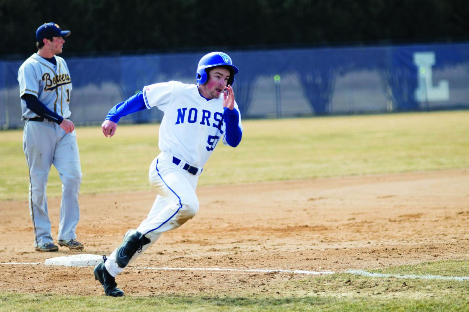 Jared Swanson ('21) runs around the bases after a hit earlier in the season.