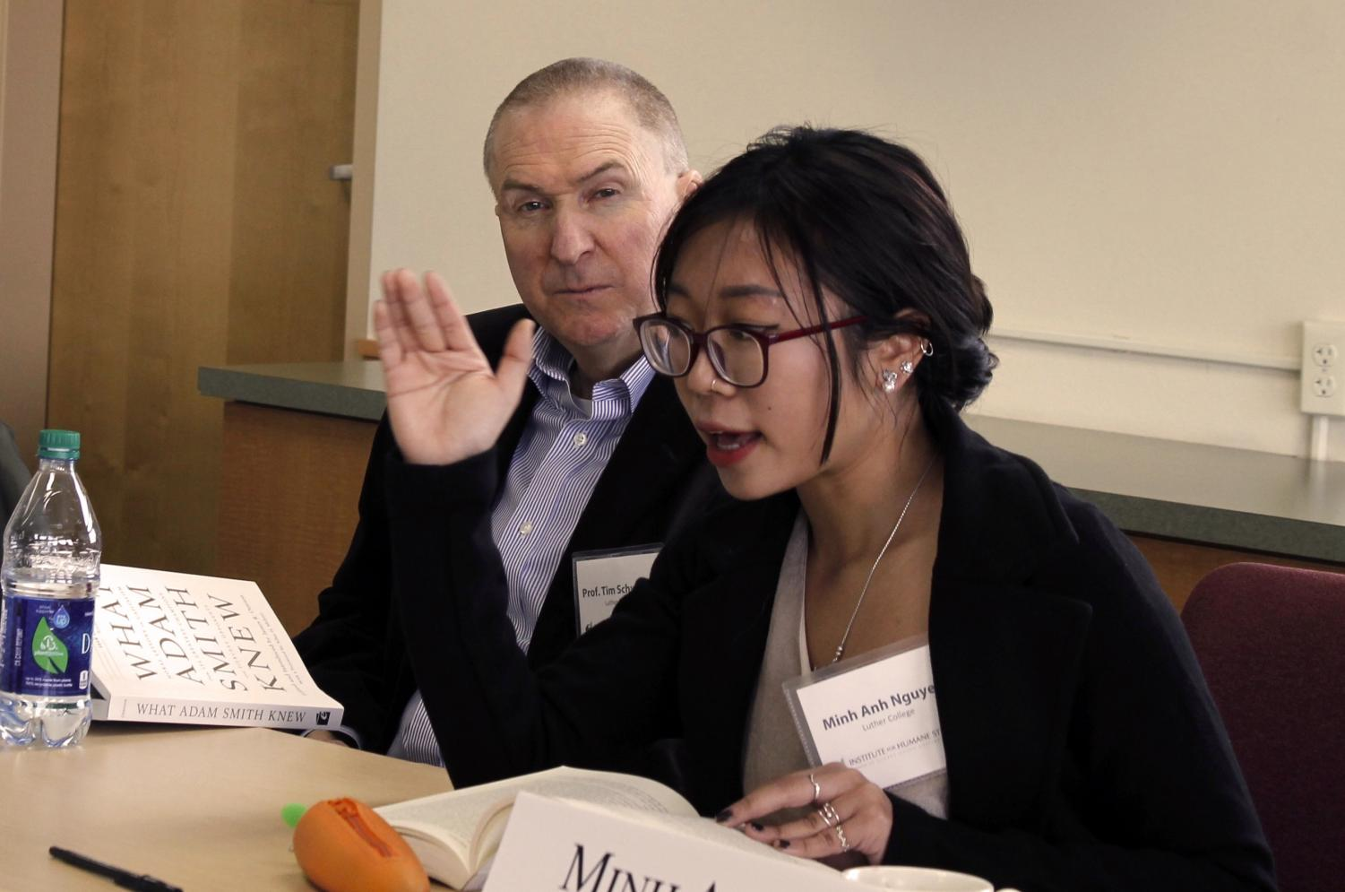 Minh Anh Nguyen ('20) and Professor of Management Tim Schweizer ('90) discuss market morality.