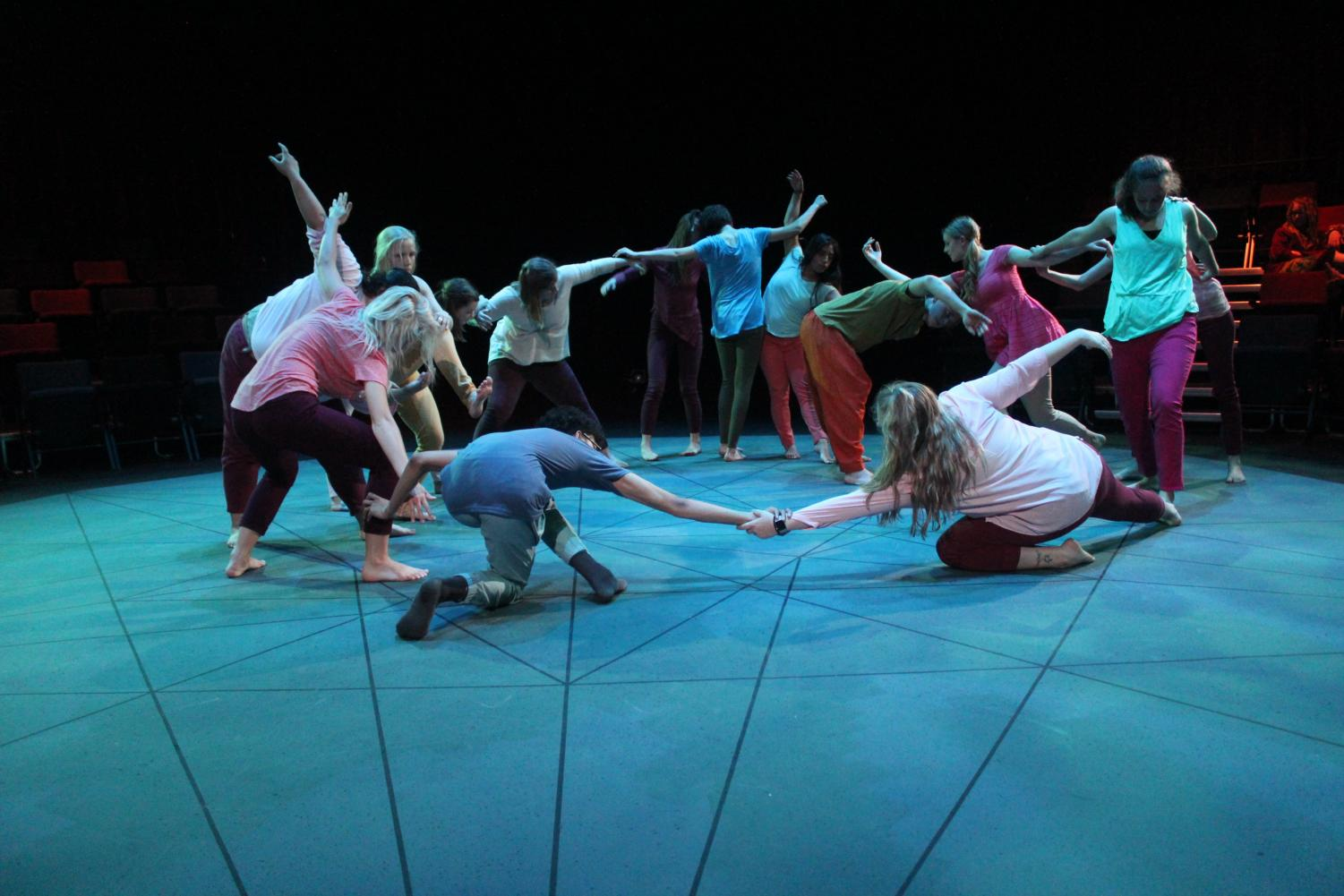 "The performers in ""Soil Turning"" dance together in the final moments of the performance."