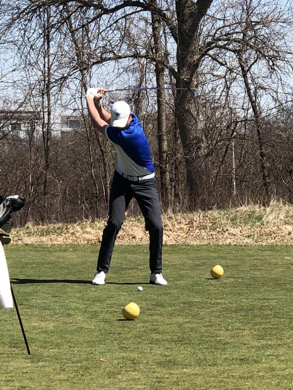 Ben Grotnes ('18) prepares to hit the ball.
