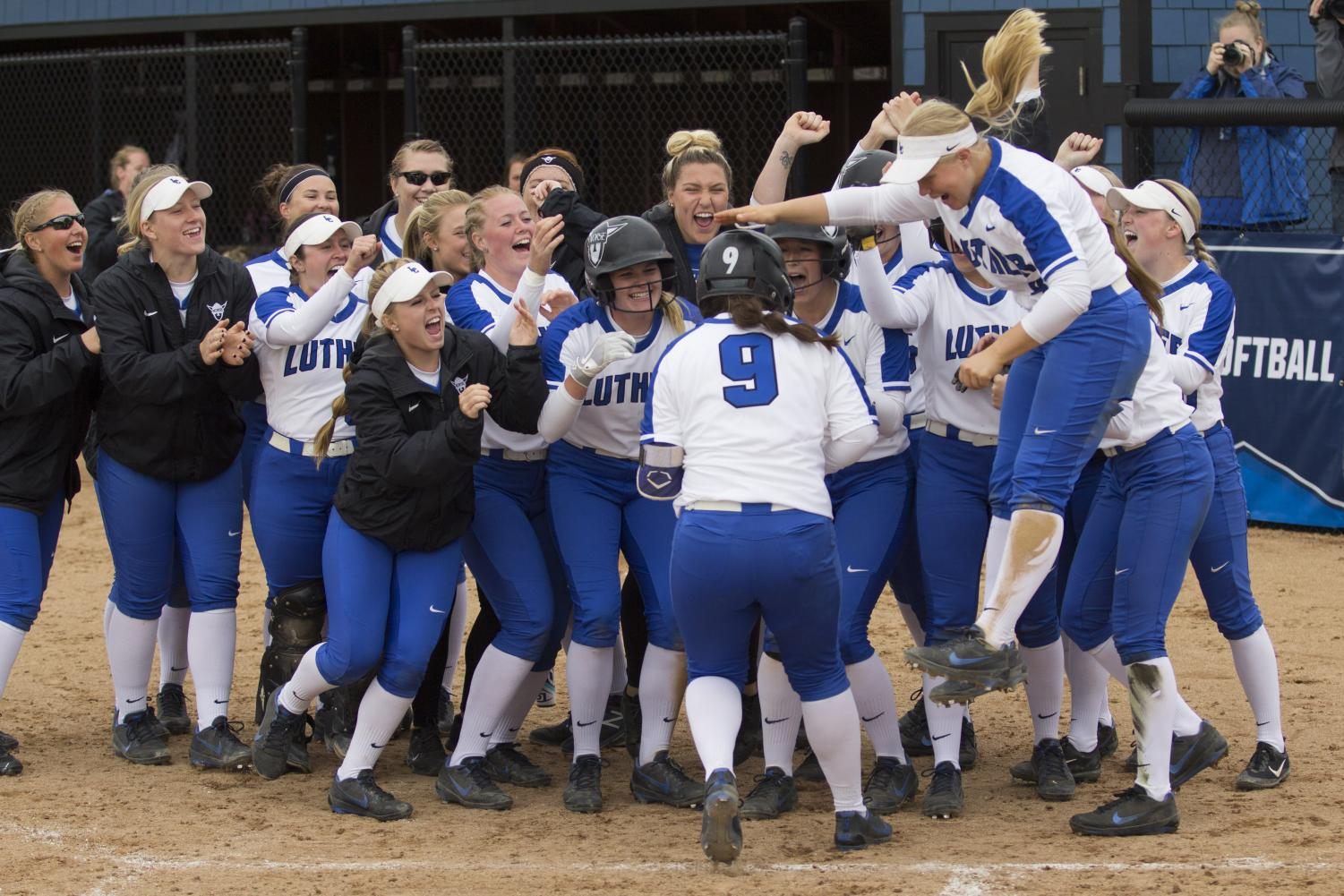 Softball celebrates after their win.