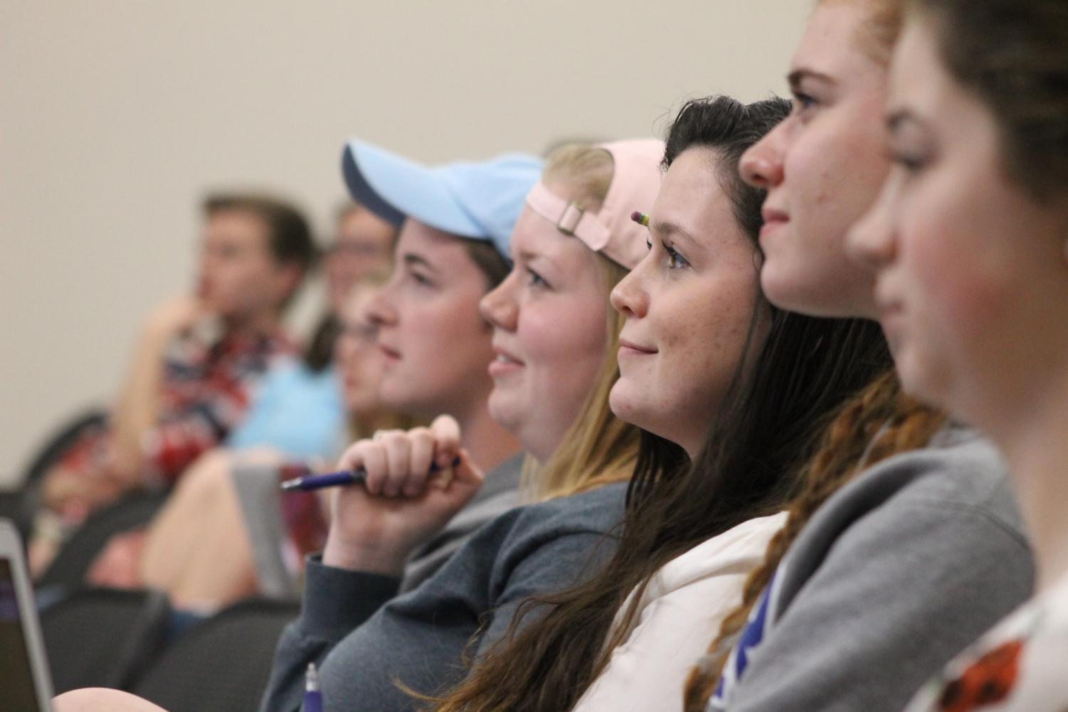 Students listen to Joshua Palkki's lecture on being both a safe person and music educator.