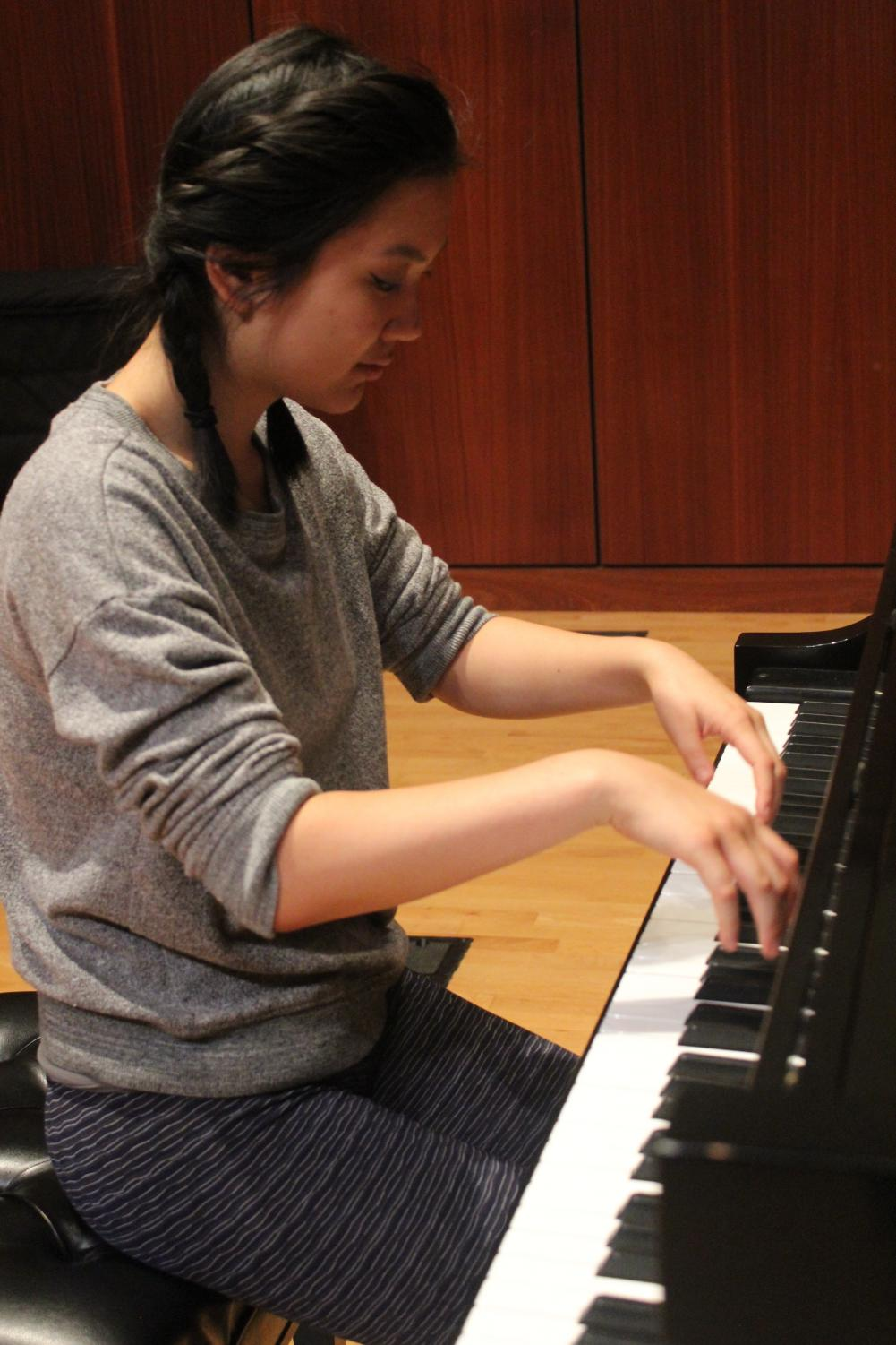 Shana Liu ('21) practices for her performance with the Des Moines Community Orchestra.