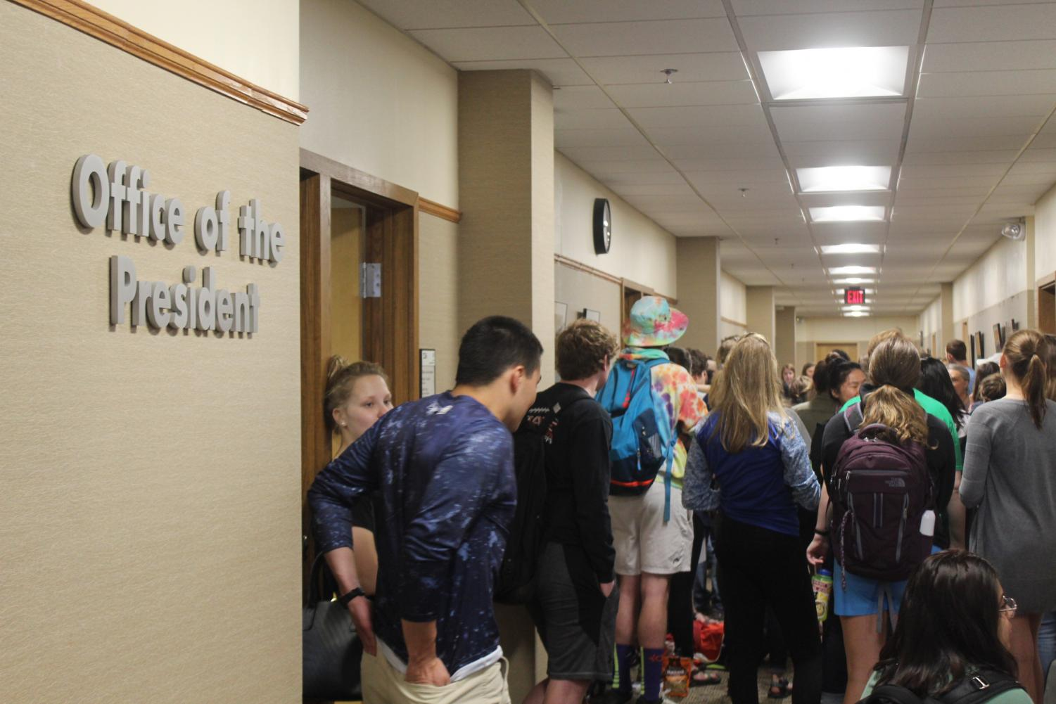 Students gather outside the office of the president during the sit-in.