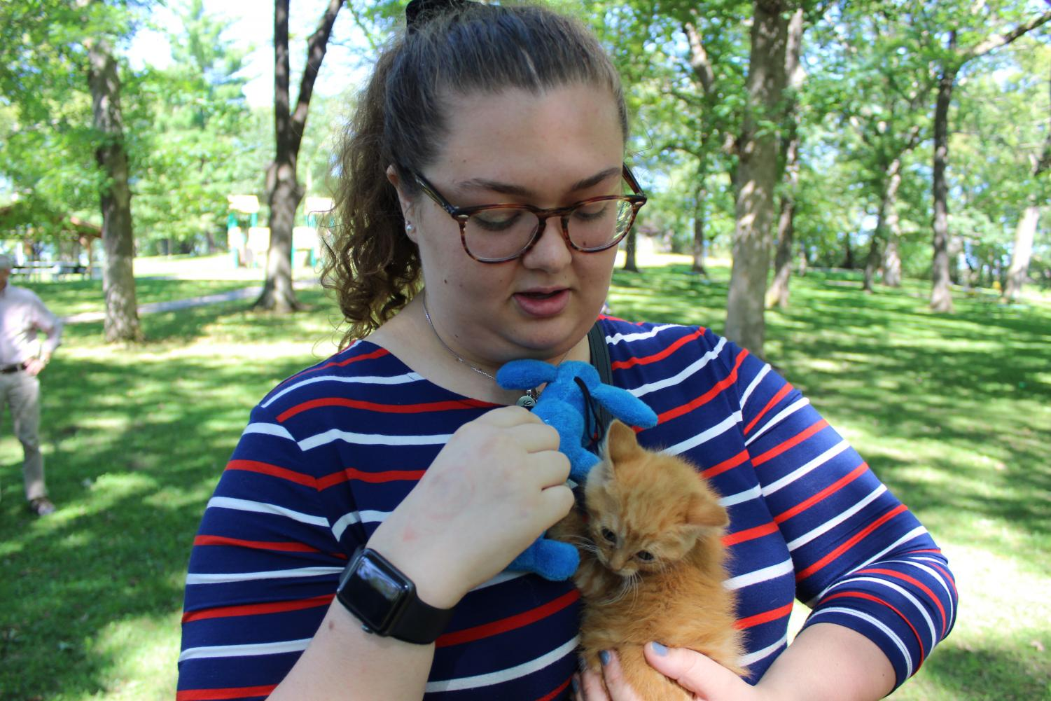 Caitlyn Hayden ('21)  holds a one month old kitten named Ginger Baker from the Humane Society