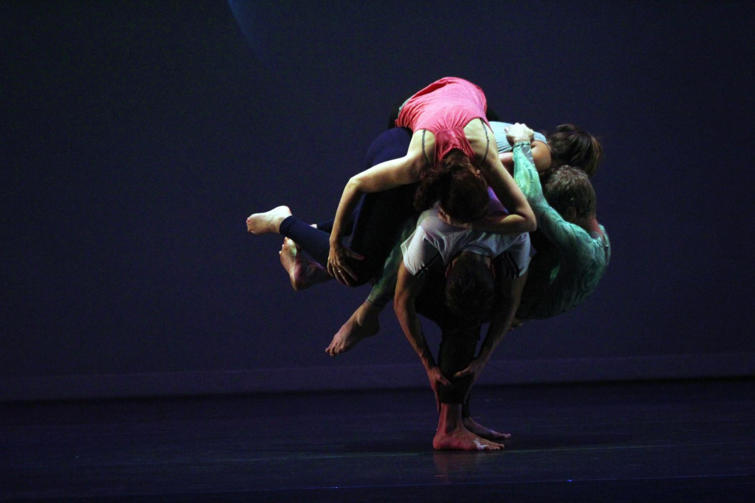 "All five members of PUSH [physical theatre] work together to emulate a planet during the piece titled ""Galileo."" Using nontraditional partnering techniques, each member of the company relies on the support of co-founder Darren Stevenson, who performed on a broken toe."